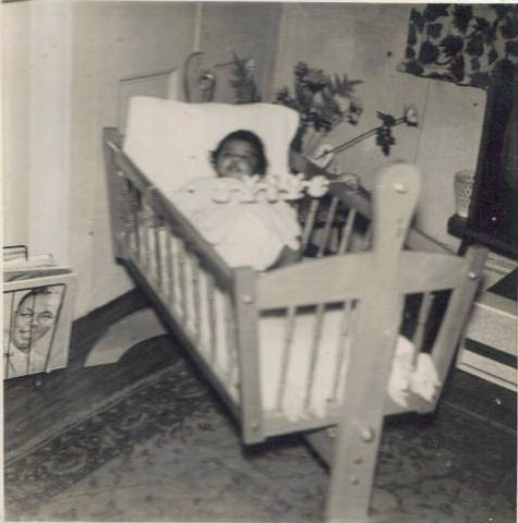 Me as a baby in a cot with the Nat King Cole Album